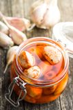 Tasty preserved garlic. Stock Images