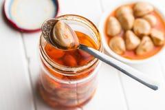 Tasty preserved garlic. Stock Image