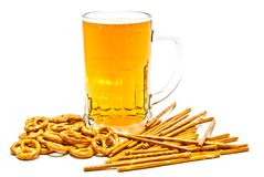 Tasty pretzels, breadsticks and light beer Royalty Free Stock Photo