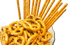 Tasty pretzels and breadsticks on a plate Royalty Free Stock Photography