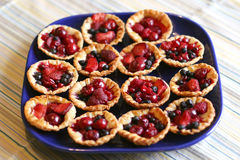 Tasty puff pastry baskets. Full of colorful berries Royalty Free Stock Photo