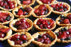 Tasty puff pastry baskets. Full of colorful berries Royalty Free Stock Image