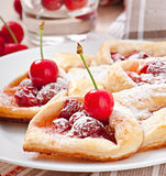 Tasty puff with a sweet cherry Royalty Free Stock Image