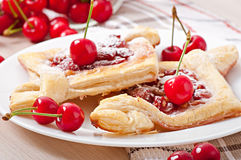 Tasty puff with a sweet cherry Royalty Free Stock Photo