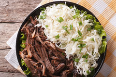 Tasty Pulled Pork and sauerkraut close up on a plate. Horizontal Royalty Free Stock Photos
