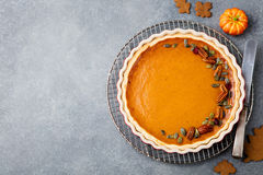 Tasty Pumpkin Pie, Tart Made For Thanksgiving Day In A Baking Dish. Grey Stone Background. Top View Royalty Free Stock Photography