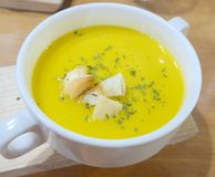 Tasty pumpkin soup with bread close up royalty free stock images