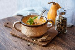 Tasty pumpkin soup on the table. Tasty pumpkin soup, seasonal autumn food stock images