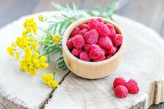 Tasty raspberries in a wooden bowl. Top view. The concept is hea. Lthy food, diet, vegetarianism, vitamins Royalty Free Stock Photography
