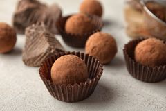 Tasty raw chocolate truffles. On light background stock photos