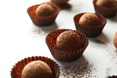 Tasty raw chocolate truffles. On marble background stock photography