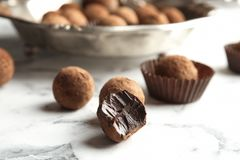 Tasty raw chocolate truffles. On marble table royalty free stock photography