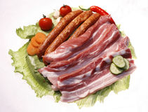 Tasty raw meat plate. Decorated with vegetables Royalty Free Stock Images