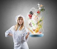 Tasty recipe of a chef. Tasty recipe of a young girl chef Royalty Free Stock Photography