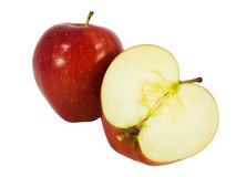 Tasty red apple cut in half. Isolated on white background Stock Images