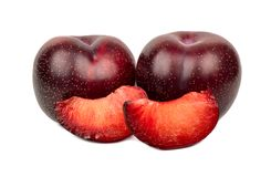 Red plum with slice. Tasty red plum with two slices on a white background Royalty Free Stock Photo