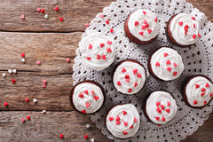 Tasty red velvet cupcakes close-up on the table. Horizontal top Royalty Free Stock Image