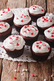 Tasty red velvet cupcakes close-up on the table. Vertical Stock Photo