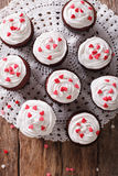 Tasty red velvet cupcakes close-up on the table. vertical top vi Stock Image