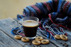 Tasty refreshing coffee and bagels on a wooden table. View Stock Photo