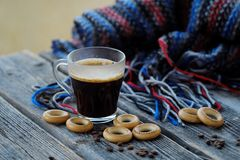 Tasty refreshing coffee and bagels on a wooden table. View Royalty Free Stock Photo