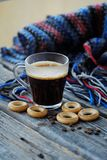 Tasty refreshing coffee and bagels on a wooden table. View Stock Photography