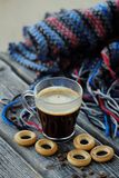 Tasty refreshing coffee and bagels on a wooden table. View Royalty Free Stock Photos