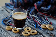 Tasty refreshing coffee and bagels on a wooden table. View Stock Image