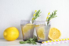 Tasty refreshing lemon cocktail with rosemary. On table royalty free stock photos