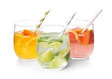Tasty refreshing lemonade with different fruits. In glasses on white background royalty free stock photo