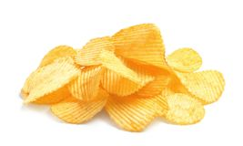 Tasty ridged potato chips. On white background royalty free stock image