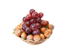 Tasty , ripe hazelnuts and grape on a white. Stock Photography