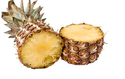 Tasty and ripe pineapple slices over the white bac Royalty Free Stock Photo