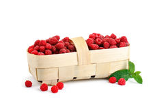 Tasty ripe raspberries in the basket on white background. An isolated object Stock Image