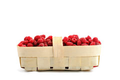 Tasty ripe raspberries in the basket on white background. An isolated object Stock Photo