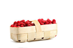 Tasty ripe raspberries in the basket on white background. An isolated object Stock Photos