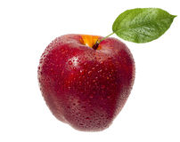 Tasty, ripe, red, juicy apple in drops of water with a green leaf Royalty Free Stock Images