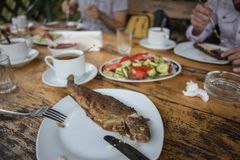 Tasty river trout on a plate with vegetables in village restaurant royalty free stock photos