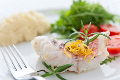 Tasty roast fish. Roast fish sprinkled with a lemon and rosemary Stock Photography