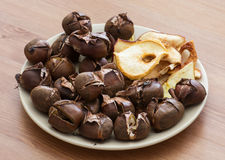 Tasty roasted chestnuts and dried sliced apples Stock Photography