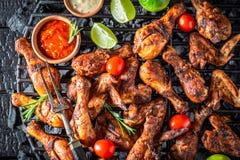 Tasty roasted chicken wings on metal grate Stock Image