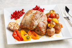 Tasty roasted loin pork with potatoes Royalty Free Stock Photo
