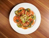 Tasty roasted marrow and tomato Stock Photo
