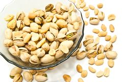 Tasty roasted pistachios and peanuts. Roasted pistachios and peanuts closeup on white Royalty Free Stock Photography