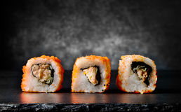 Tasty rolls on black Royalty Free Stock Photography