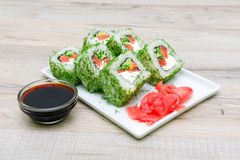 Tasty rolls and pickled ginger on a plate. horizontal photo. Stock Photography