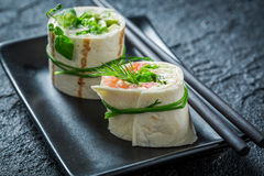 Tasty rolls with salmon, cheese and vegetables for a brunch Stock Image