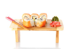 Tasty rolls served on wooden plate Stock Image