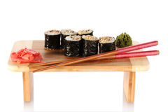 Tasty rolls served on wooden plate Royalty Free Stock Photo
