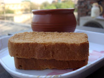 Tasty rusk on focus with tea cup. Tasty rusk on focus with tea in background Stock Image